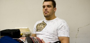 Dean Lister looks up from his programme