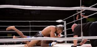 Karl Amoussou chokes John Doyle