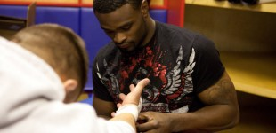 Tyron Woodley wrapping Chandlers hands
