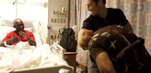 TIm Kennedy shows patient a guillotine