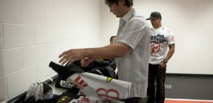 KJ Noons unpacking in locker room